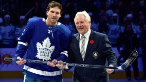 Former Maple Leafs great Darryl Sittler, right, presents Toronto Maple Leafs defenceman Ron Hainsey with a silver hockey stick to commemorate his 1000th NHL hockey game ahead of NHL hockey action between the Maple Leafs and Dallas Stars in Toronto on Thursday, November 1, 2018. THE CANADIAN PRESS/Frank Gunn