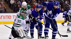 Toronto Maple Leafs left wing Zach Hyman (11) and Toronto Maple Leafs left wing Andreas Johnsson (18) battle for the puck with Dallas Stars defenceman John Klingberg (3) in front of Dallas Stars goaltender Anton Khudobin (35) during third period NHL hockey action in Toronto on Thursday, November 1, 2018. THE CANADIAN PRESS/Frank Gunn