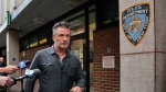 Actor Alec Baldwin walks out of the New York Police Department's 10th Precinct, Friday, Nov. 2, 2018, in New York. Baldwin was arrested Friday after allegedly punching a man in the face during a dispute over a parking spot outside his New York City home, authorities said.(Photo/Julie Jacobson)