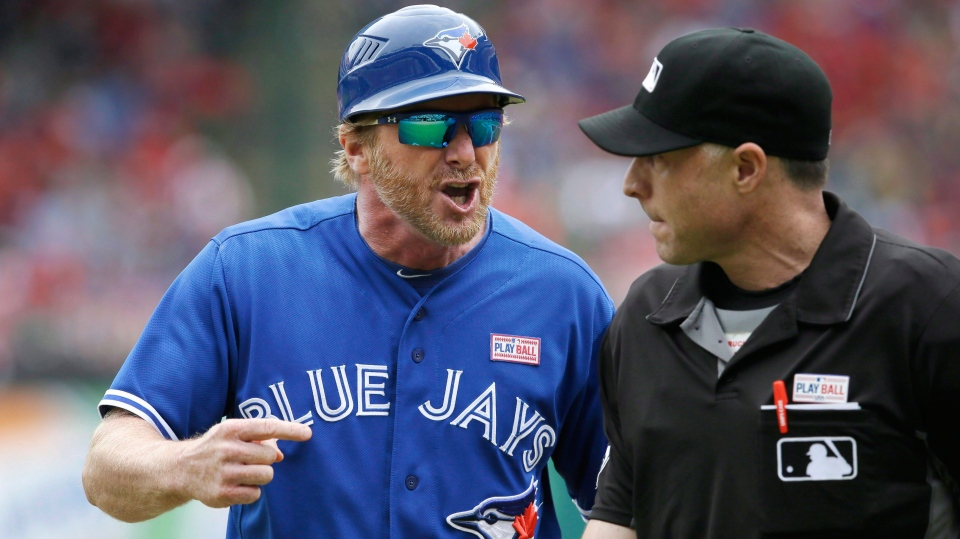 Toronto Blue Jays first base coach Tim Leiper, left, yells at home plate umpire Dan Iassogna after Leiper was ejected during the third inning of a baseball game against the Texas Rangers in Arlington, Texas on May 15, 2016. The Toronto Blue Jays have reportedly made more changes to their coaching staff a week after hiring a new manager.Multiple media reports Saturday said the team had fired hitting coach Brook Jacoby and first base coach Tim Leiper. THE CANADIAN PRESS/AP, LM Otero