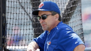 Toronto Blue Jays hitting coach Brook Jacoby watches the team practice before Game 4 of baseball's American League Division Series against the Texas Rangers in Arlington, Texas on October 12, 2015. The Toronto Blue Jays have reportedly made more changes to their coaching staff a week after hiring a new manager.Multiple media reports Saturday said the team had fired hitting coach Brook Jacoby and first base coach Tim Leiper. THE CANADIAN PRESS/AP, LM Otero