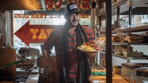 Chef Anthony Rose offers up a plate of karnatzel, house-smoked pastrami and a selection of side dishes at his Rose and Sons deli in Toronto, Tuesday, October 23, 2018. THE CANADIAN PRESS/Galit Rodan