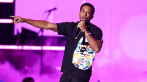In this Sept. 21, 2018, file photo Ludacris performs at the 2018 iHeartRadio Music Festival Day 1 held at T-Mobile Arena in Las Vegas. Ludacris and Migos will represent Atlanta and hip-hop culture when they perform at the EA SPORTS BOWL days before the Super Bowl next year, Electronic Arts Inc. and OnLocation Experiences announced Monday, Nov. 5. (Photo by John Salangsang/Invision/AP, File)