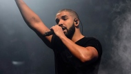 In this June 27, 2015 file photo, Canadian singer Drake performs on the main stage at Wireless festival in Finsbury Park, London. (Photo by Jonathan Short/Invision/AP, File)