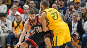 Utah Jazz center Rudy Gobert (27) defends against Toronto Raptors center Jonas Valanciunas, left, in the first half during an NBA basketball game Monday, Nov. 5, 2018, in Salt Lake City. (AP Photo/Rick Bowmer)