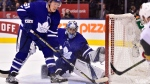 Toronto Maple Leafs defenceman Jake Gardiner (51) clears the puck as Toronto Maple Leafs goaltender Frederik Andersen (31) looks on during third period NHL action against the Vegas Golden Knights in Toronto on Tuesday, Nov. 6, 2018. THE CANADIAN PRESS/Frank Gunn