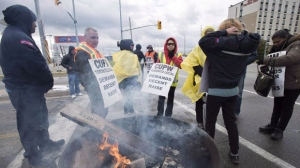 Striking Canada Post workers walk the picket line in Mississauga, Ontario on Tuesday October 23, 2018. THE CANADIAN PRESS/Frank Gunn