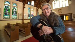 Musician Colleen Newell holds her guitar at St. Saviour's Anglican Church in Toronto on Friday, November 2, 2018. It's long been known that Alzheimer's patients often retain musical memories, even when recall of names, faces and places has been lost as the disease relentlessly destroys key areas of the brain.THE CANADIAN PRESS/Frank Gunn