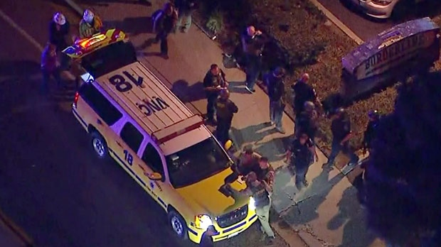 This image made from aerial video show officers around a Police SUV in the vicinity of a shooting in Thousand Oaks, California, early Thursday, Nov. 8, 2018. Authorities say there were multiple injuries - including one officer - after a man opened fire in Southern California bar late Wednesday. (KABC via AP)