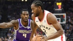 Toronto Raptors forward Kawhi Leonard, right, drives to the basket as Sacramento Kings guard Iman Shumpert defends during the second half of an NBA basketball game Wednesday, Nov. 7, 2018, in Sacramento, Calif. The Raptors won 114-105. (AP Photo/Rich Pedroncelli)