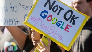 In this Nov. 1, 2018, file photo workers protest against Google's handling of sexual misconduct allegations at the company's Mountain View, Calif., headquarters. (AP Photo/Noah Berger, File)