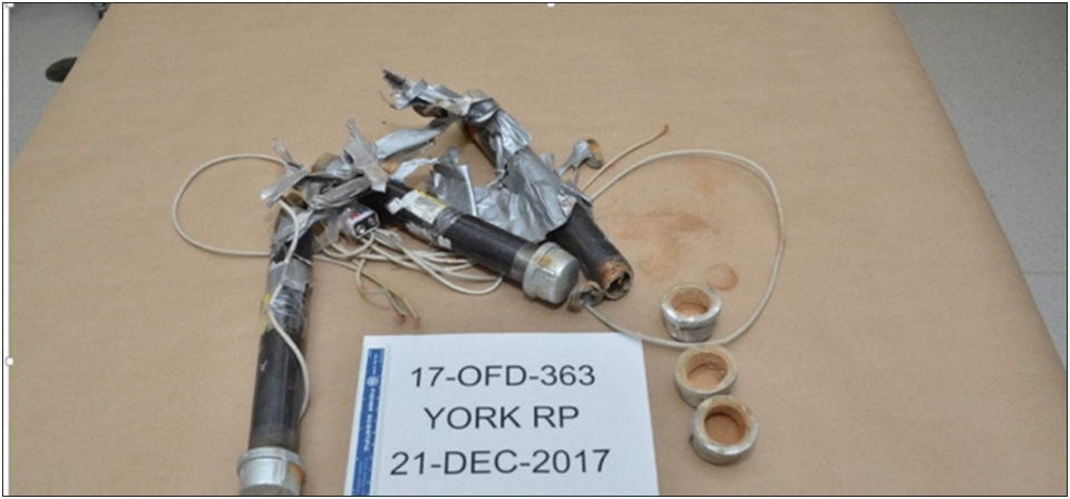 Pipe bomb components including electrical wires are seen. (Special Investigations Unit)