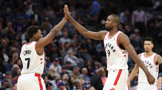 Toronto Raptors' Kyle Lowry, left, and Serge Ibaka give each other a high five during the second half of the Raptors 114-105 win over the Sacramento Kings in a NBA basketball game Wednesday, Nov. 7, 2018, in Sacramento, Calif. (AP Photo/Rich Pedroncelli)