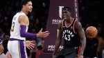 Toronto Raptors' Pascal Siakam, right, celebrates after dunking next to Los Angeles Lakers' Josh Hart (3) during the first half of an NBA basketball game Sunday, Nov. 4, 2018, in Los Angeles. (AP Photo/Marcio Jose Sanchez)
