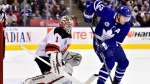 Toronto Maple Leafs centre Patrick Marleau (12) tries to tip in the puck as New Jersey Devils goaltender Keith Kinkaid (1) defends during first period NHL action in Toronto on Friday, Nov. 9, 2018. THE CANADIAN PRESS/Frank Gunn