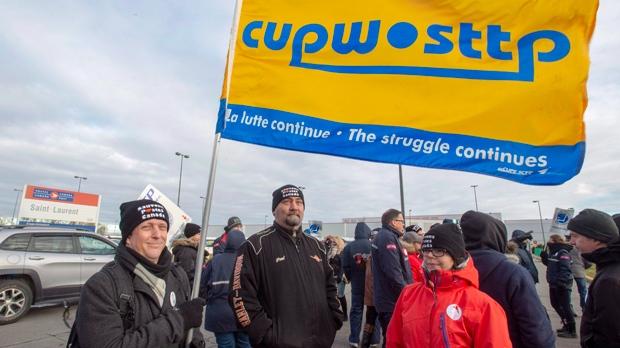 Striking postal workers