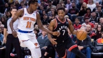 Toronto Raptors guard Kyle Lowry (7) protects the ball from New York Knicks guard Frank Ntilikina (11) during first half NBA basketball action in Toronto on Saturday, November 10, 2018. THE CANADIAN PRESS/Nathan Denette