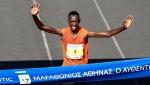 Kenya's Misoi Brimin Kipkorir crosses the finish line to win the 2018 Athens Marathon, in Athens, Sunday, Nov. 11, 2018. (InTime News via AP)