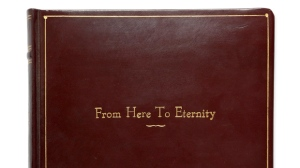 This image provided by Sotheby's shows a copy of 'From Here to Eternity,' in which Frank Sinatra won an Academy Award, and is part of more than 200 item belonging to Frank and Barbara Sinatra going up for auction. Sotheby's on Monday, Nov. 12, 2018, unveiled the contents of Lady Blue Eyes: Property of Barbara and Frank Sinatra which will go on the block in a series of auctions in New York in December. (Courtesy Sotheby's via AP)
