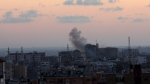 Smoke rises following Israeli strikes on Gaza City, Monday, Nov. 12, 2018. Palestinian militants on Monday fired dozens of rockets and mortar shells into southern Israel, critically wounding an Israeli teen, in an intense barrage of projectiles aimed at seeking revenge for a deadly Israeli military incursion late Sunday. The Israeli military responded by dispatching fighter jets to strike throughout the Gaza Strip. (AP Photo/Adel Hana)