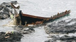 """A wooden boat is left after being washed ashore in Tsuruoka, Yamagata prefecture, northern Japan Monday, Dec. 4, 2017. Coast guard said a Japanese fishing boat picked up a male body floating off the coast of Sakata in the prefecture and two more bodies washed up on a nearby beach an hour and half later. Twenty-eight of the vessels, dubbed """"ghost boats,"""" were detected in November, up from just four in November last year. (Kyodo News via AP)"""