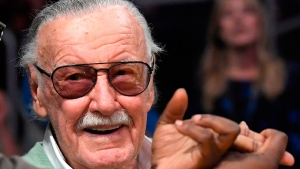 In this Oct. 27, 2017 file photo, famed comic book creator Stan Lee appears at an NBA basketball game between the Los Angeles Lakers and the Toronto Raptors, in Los Angeles. (AP Photo/Mark J. Terrill File)