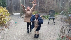 A screengrab from video shows two Eritrean children reacting gleefully to their first Canadian snowfall. A woman who shared a video says the overwhelming reaction to the clip is reaffirming her faith in the country as a welcoming place for newcomers. THE CANADIAN PRESS/HO-Rebecca Davies MANDATORY CREDIT