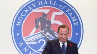 Hockey Hall of Fame inductee and NHL Commissioner Gary Bettman looks at his ring during a press conference in Toronto on Friday, November 9, 2018. THE CANADIAN PRESS/Nathan Denette