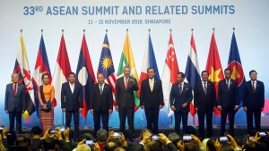 ASEAN Leaders pose for a group photo during the opening ceremony for the 33rd ASEAN Summit and Related Summits Tuesday, Nov. 13, 2018, in Singapore. (AP Photo/Bullit Marquez)