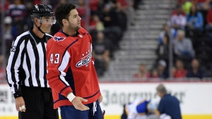 In this Sept. 30, 2018, file photo, Washington Capitals right wing Tom Wilson (43) is escorted by an official off the ice after he checked St. Louis Blues center Oskar Sundqvist, background, during the second period of an NHL preseason hockey game in Washington. Wilson has had his 20-game suspension reduced to 14 by a neutral arbitrator and is eligible to play immediately. Wilson has already served 16 games of his suspension for an illegal check to the head of St. Louis forward Oskar Sundqvist in each team's preseason finale. The ruling by Shyam Das allows Wilson to return as soon as Tuesday night, Nov. 13, 2018, at Minnesota, and the 24-year-old will recoup $378,049 of the $1.26 million he initially forfeited as part of the suspension. (AP Photo/Nick Wass, File)