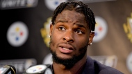 In this Oct. 22, 2017, file photo, Pittsburgh Steelers running back Le'Veon Bell (26) answers questions at a post-game meeting with reporters following a 29-14 win over the Cincinnati Bengals in an NFL football game in Pittsburgh. (AP Photo/Fred Vuich, File)