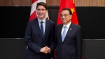 Canadian Prime Minister Justin Trudeau meets with Chinese Premier Li Keqiang before the Canada-China Annual Leaders dialogue in Singapore on Wednesday November 14, 2018. THE CANADIAN PRESS/Adrian Wyld