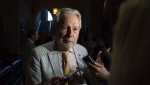 Sen. Peter Harder, Government Representative in the Senate, speaks to reporters after the vote on Bill C-45, the Cannabis Act in the Senate on Parliament Hill in Ottawa on Tuesday, June 19, 2018. The government's representative in the Senate is urging senators to stop dragging their feet and create an independent body to oversee their expenses. THE CANADIAN PRESS/Justin Tang