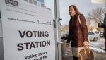 A Calgarian arrives to vote in a plebiscite on whether the city should proceed with a bid for the 2026 Winter Olympics, in Calgary, Alta., Tuesday, Nov. 13, 2018.THE CANADIAN PRESS/Jeff McIntosh