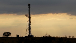 FILE - This Wednesday, May 9, 2012 file photo, shows a drilling rig near Kennedy, Texas. The International Energy Agency said Wednesday Nov. 14, 2018, that global oil supplies are growing rapidly as Saudi Arabia, the United States and Russia pump oil at a record rate in response to fears of higher prices as a result of renewed U.S. sanctions on Iran. (AP Photo/Eric Gay, File)