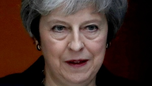 British Prime Minister Theresa May leaves 10 Downing Street heading to Parliament for Prime Minister's questions in London, Wednesday, Nov. 14, 2018. May will try to persuade her divided Cabinet on Wednesday that they have a choice between backing a draft Brexit deal with the European Union or plunging the U.K. into political and economic uncertainty. (AP Photo/Matt Dunham)