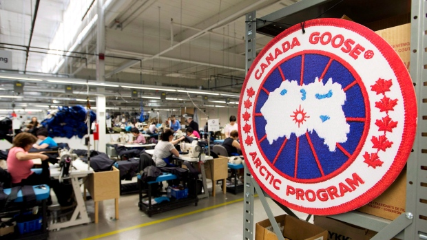 bbf1042434d Employees work with Canada Goose jackets at the Canada Goose factory in  Toronto on Thursday