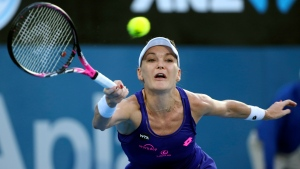"In this Jan. 13, 2017, file photo, Agnieszka Radwanska, of Poland, plays a shot to Britain's Johanna Konta during the women's singles final at the Sydney International tennis tournament in Sydney, Australia. Radwanska says she is retiring from tennis after a 13-year career. The 29-year-old, who reached a career-high ranking of No. 2, says she is ""no longer able to train and play the way I used to."" (AP Photo/Rick Rycroft, FIle)"
