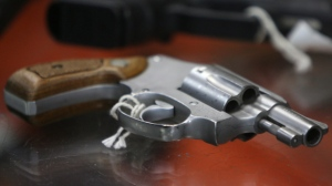 In this June 26, 2008 file photo, a chrome plated revolver rests on top of a glass display case at John Jovino Co. in New York. (AP Photo/Seth Wenig, File)