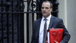 Britain's Secretary of State for Exiting the European Union Dominic Raab leaves Downing Street to attend Prime Minister's questions in London, on Nov. 14, 2018. (Matt Dunham / AP)