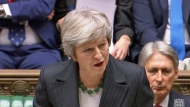 In this grab taken from video, Britain's Prime Minister Theresa May makes a statement on the draft Brexit withdrawal agreement, in the House of Commons in London, Thursday Nov. 15, 2018. (PA via AP)