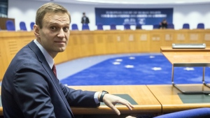 Russian opposition leader Alexei Navalny attends his hearing at the European Court of Human Rights in Strasbourg, eastern France, Thursday, Nov.15, 2018. The European Court of Human Rights has ruled that Russian authorities' repeated arrests of opposition leader Alexei Navalny were politically driven. (AP Photo/Jean-Francois Badias)