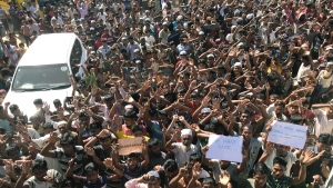 Rohingya refugees shout slogans against repatriation at Unchiprang refugee camp near Cox's Bazar, in Bangladesh, Thursday, Nov. 15, 2018. About 1,000 Rohingya Muslim refugees demonstrated Thursday at a camp in Bangladesh against plans to repatriate them to Myanmar, from where hundreds of thousands fled army-led violence last year.(AP Photo/Dar Yasin)