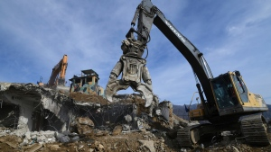 Construction equipments destroy a South Korean guard post in the Demilitarized Zone dividing the two Koreas in Cheorwon Thursday, Nov. 15, 2018. Relations between the Koreas have improved this year, with the North entering disarmament talks with a vague promise to achieve complete denuclearization of the Korean Peninsula. (Jung Yeon-je/Pool Photo via AP)