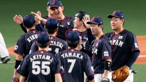 All Japan closer Yasuaki Yamasaki, back facing camera, celebrates with teammates on the mound after beating MLB All-Stars 4-1 in Game 6 at their All-Stars Series baseball at Nagoya Dome in Nagoya, central Japan, Thursday, Nov. 15, 2018. Japan improved to 5-1 in the series. (Kyodo News via AP)