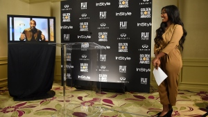 Isan Elba, daughter of Idris Elba, left on screen, appears at a press conference announcing her a 2019 Golden Globe Ambassador at The Four Seasons Los Angeles on Wednesday, Nov. 14, 2018. (Photo by Jordan Strauss/Invision/AP)