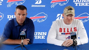 In this July 26, 2018 file photo Buffalo Bills general manager Brandon Beane, left, and coach Sean McDermott speak to the media at the NFL football team's training camp in Pittsford, N.Y. With little money to spend and few impact players interested in signing with the Bills given the uncertainty at quarterback this past offseason, Beane understood Buffalo's offense was going to endure its struggles. (AP Photo/Adrian Kraus, file)