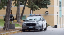 A police car is parked outside St. Michael's College School in Toronto on Thursday, November 15, 2018. An investigation is underway into an alleged sexual assault at a prestigious private school in Toronto, police said Wednesday as the institution announced it had expelled students over two serious incidents. THE CANADIAN PRESS/Frank Gunn