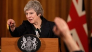 Britain's Prime Minister Theresa May takes questions during a press conference inside 10 Downing Street in London, Thursday, Nov. 15, 2018.  (AP Photo/Matt Dunham, Pool)