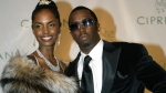 'Diddy' Combs and Kim Porter, left, pose on Nov. 4, 2004, as they arrived for Combs' 35th birthday celebration in New York. (AP Photo/Kathy Willens)